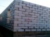 Завершение кладки стен первого этажа
